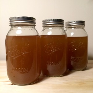 Vegetable broth in Ball jars for freezing